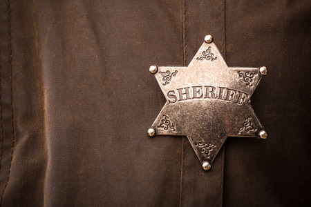 Close up of sheriff badge when on his coat duster Stok Fotoğraf - 37563365