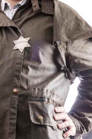 sheriff badge: Close up de insignia de sheriff cuando en su plumero abrigo Foto de archivo
