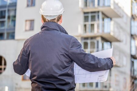 An architect or constructor manager looking at project