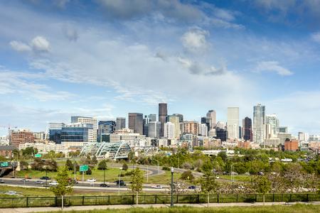 denver skyline with mountains: Denver city center, Capital of Colorado State, USA Stock Photo