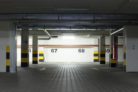 Illuminated empty parking lot .