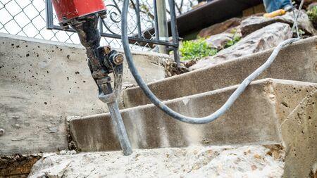 presslufthammer: Jackhammer working on the construction site . Lizenzfreie Bilder