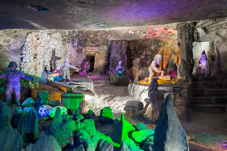 colorfully: Sculptures colorfully illuminated in famous salt mine in Wieliczka, Poland