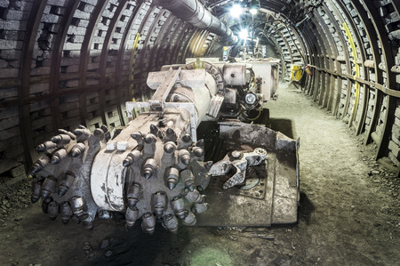 Underground mine excavator facing coal wall . Stock Photo