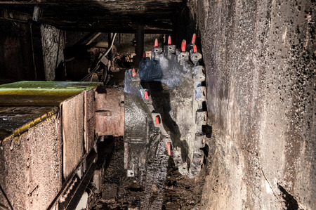 facing a wall: Underground mine excavator facing coal wall . Stock Photo