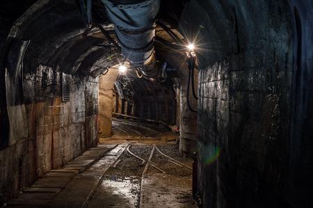 tunneling: Real underground post mine illuminated tunnel .