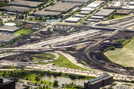 Road construction in industrial area photographed from above