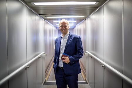 navy blue suit: Businessman leaving the plane after nice air travel Stock Photo