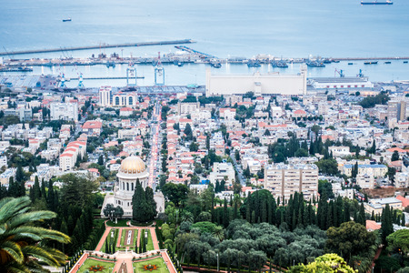 baha: Panorama of Haifa - port, Bahai gardens and modern buildings at sunset, Israel Stock Photo
