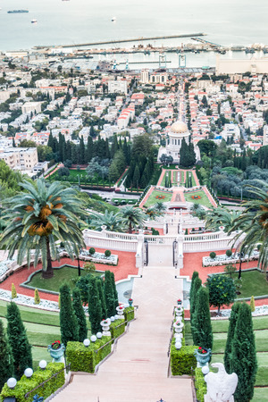 baha: Panorama of Haifa - port, Bahai gardens and modern buildings at sunset, Israel Stock Photo