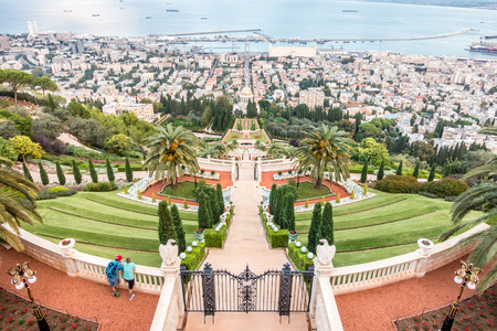 baha: Panorama of Haifa - port, Bahai gardens and modern buildings at sunset, Israel Editorial