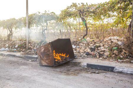 riots: Burning trash bin after riots in Hebron, Palestine, Israel Stock Photo