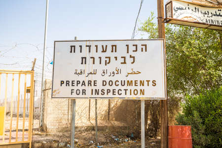 hebrew: Prepare documents for inspection sign in English, Hebrew and Arabic at Israeli and palestinian border