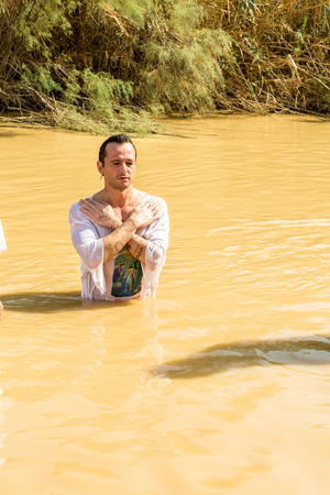 baptism of jesus: Jericho, Israel - November 2, 2015: Organized baptism for group of pilgrims in river of Jordan, the place which is believed that Jesus was baptized