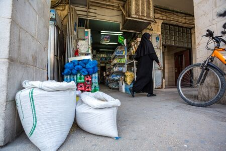 palestinian: Jericho, Palestine - November 2, 2015: Palestinian woman doing shopping in simply shops of Jericho Editorial