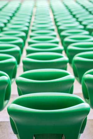 tribune: Green plastic seats on the tribune at modern stadium