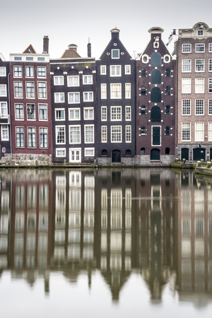 reflexion: Charming houses and its reflexion in canal of Amsterdam, The Netherlands Foto de archivo