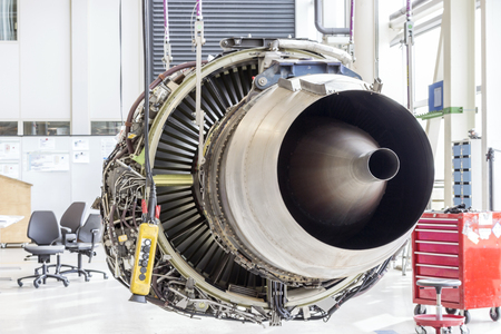 aluminum airplane: An airplane engine during maintenance in a warehouse