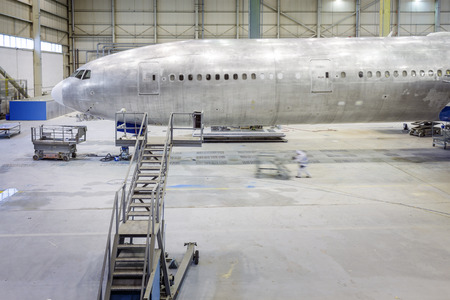 aluminum airplane: Refurbishment of an airplane. Grinding and painting.