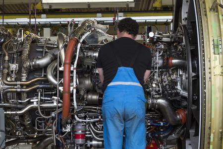 aluminum airplane: Worker repairing and maintaining engine of airplane