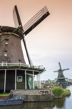 schans: Old, wooden windmills in Zaanse Schans, The Netherlands