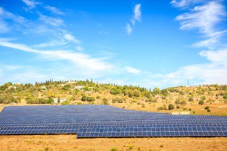 Solar panels next to small village in Algarve, Portugal
