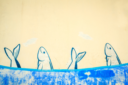 sardine: School of sardines painted on the wall, Portugal Stock Photo