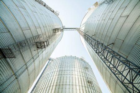 nebraska: Huge, silver, shining agricultural silos on a farm, USA