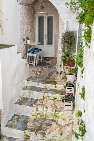 Romantic urban table and chairs for two people, Ostuni, Italy Stock Photo