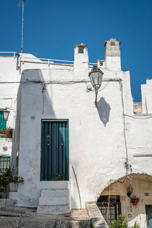 characteristic: Narrow street in romantic white city of Ostuni, Puglia, Italy