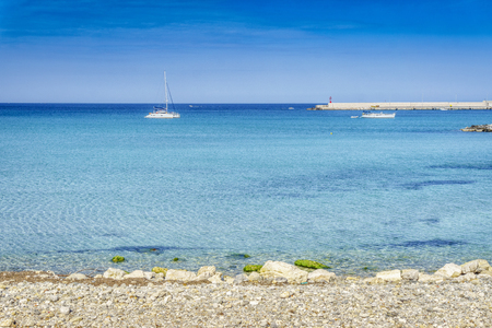 White sail boats at Otranto coast, Apulia, Italy