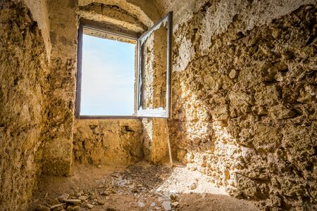 abandon: Window in old fortress during sunny day, Brindisi, Italy Stock Photo