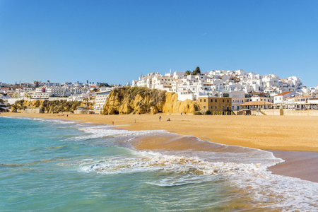 Wide, sandy beach in white city of Albufeira by Atlantic Ocean, Algarve, Portugal