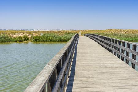 Wooden bridge by Praia dos Salgados Nature Reserve, Algarve, Portugal