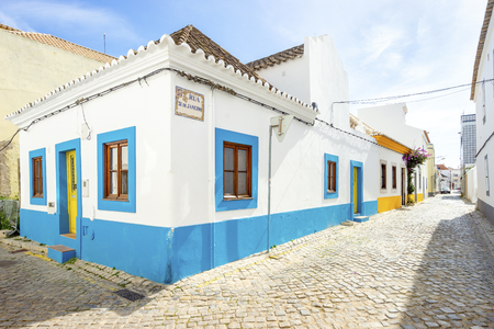 White  and blue traditional portuguese house in Tavira, Algarve, Portugal Stock Photo