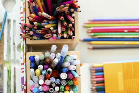 Plenty of colorful crayons and markers in two wooden boxes Stok Fotoğraf