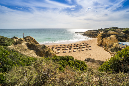 Sandy wide beach with umbrellas and sunbeds to rent, Praia do Castelo, Algarve, Portugal