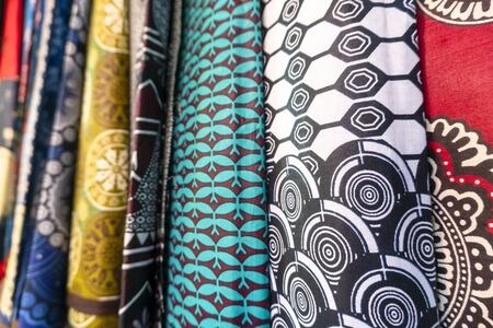 Plenty of colorful african fabrics on local open air market, Maputo, Mozambique