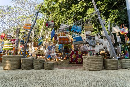 Traditional african market selling colorful  bags hanged on trees, FEIMA, Maputo, Mozambique