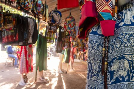 Traditional african market selling colorful  backpacks, clothes and fabrics, FEIMA, Maputo, Mozambique Stok Fotoğraf