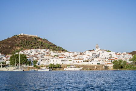 Sanlucar de Guadiana pictured from spanish - portuguese boder which is Guadiana river Stock Photo