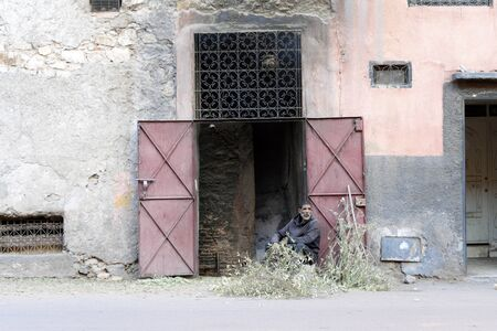 Marrakech, Morocco - January 7, 2020: Man producing charcoal in house of old town 版權商用圖片