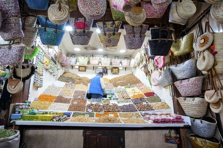 Marrakech, Morocco - January 7,2020: Arabic shop with grains, dry fruits, nuts and bags located in old town of Marrakech