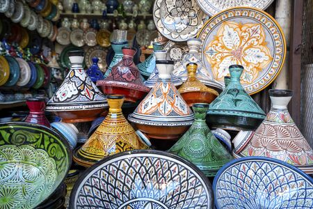 Colorful clay tagines sold in old town of Marrakech, Morocco