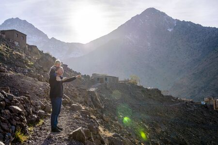 Father showing beauty of nature to his small boy in Atlas mountains, Morocco Zdjęcie Seryjne