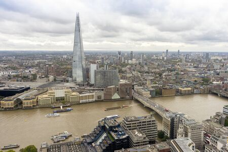 Aerial view of dense London upon Thames river, United Kingdom Stock fotó