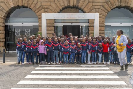 Pretoria, South Africa - May 24, 2019: Group of children taking photo on their excursion to Union Buildings