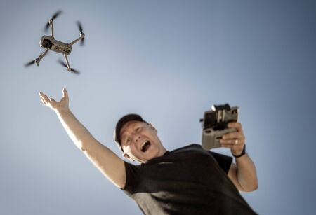 Desperate man tries to catch drone that flies away