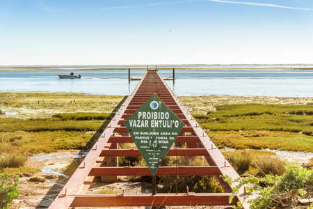 May 5, 2020 - Olhao, Portugal: Beautiful landscape with a closed pier in Ria Formosa Natural Park, Olhao, Algarve, Portugal Editorial