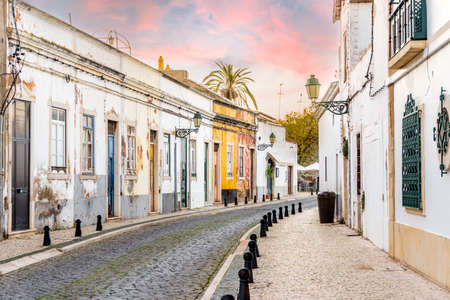 Traditional old Portuguese houses in old town of Faro by sunset, Algarve, Portugal